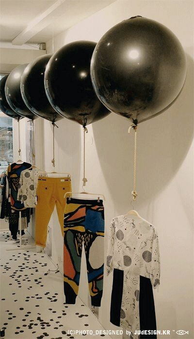 helium gassed balloons floating can draw attention to the shop from long distance and also be used as display unit at the same time. depending on the hight of the space we have i think this can be a really creative and fun idea.