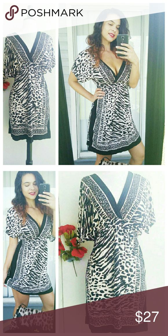 Sexy animal print party dress This dress has an elastic waist. The material is very soft and comfortable, with a deep V- plunge in the front and back.   Wear with a black bra.   New without tags. 100% Rayon. one clothing Dresses Mini