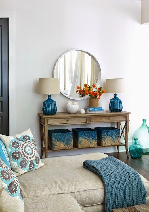 Tracery Interiors - living rooms - round capiz mirror, peacock blue lamps, two drawer console table with shelf, built in table shelf, blue b...