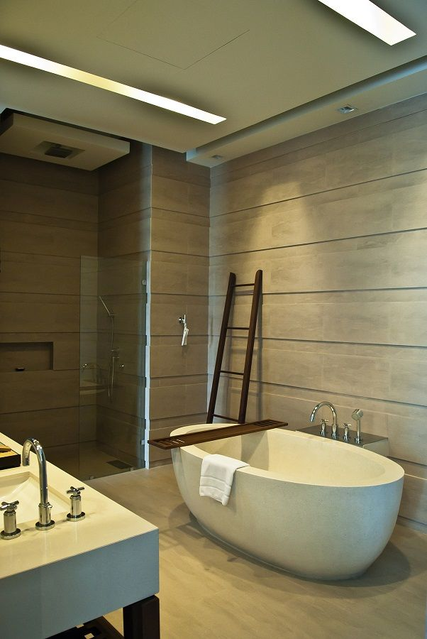Tips to create visual flow: *Continuous wall finishes *Repetition of textures *Frameless glass fittings #homedecor