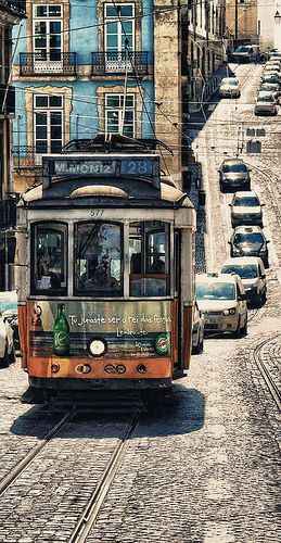 Lisboa, Portugal.. Spread across steep hillsides that overlook the Rio Tejo, Lisbon offers all the delights you'd expect of Portugal's star attraction. Gothic cathedrals, majestic monasteries and quaint museums are all part of the colourful cityscape. As bright yellow trams wind their way through curvy tree-lined streets, Lisboêtas stroll through the old quarters, much as they've done for centuries.