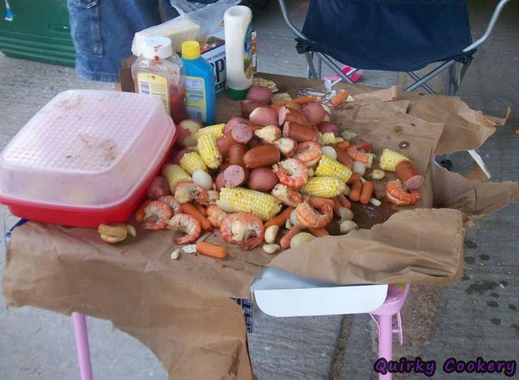 Shrimp boil with corn on the cob, garlic, polish sausage, carrots.