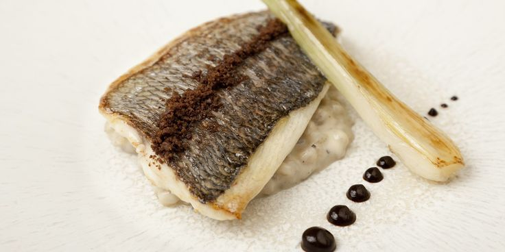 Grey mullet with pearl barley pudding, black garlic and spring onion