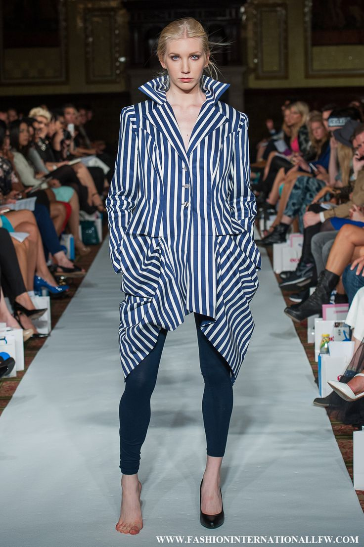 Lenie Boya London Fashion Week Spring/Summer 2015. Futuristic Blue and White Striped Coat, with 3d Fabric Manipulation Details and high standing collar.