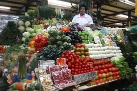 A vendor stands behind a massive fruit stand at Mercado San Juan, #Mexico City's ultimate market for chefs and #foodies.