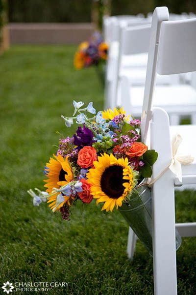 Sunflower rose wedding ceremony | Flower arrangements in metal buckets along the aisle