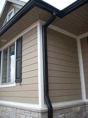 Black Gutters. windows are white vinyl with black trim and exterior is blue/grey.. I think its gonna look gooood