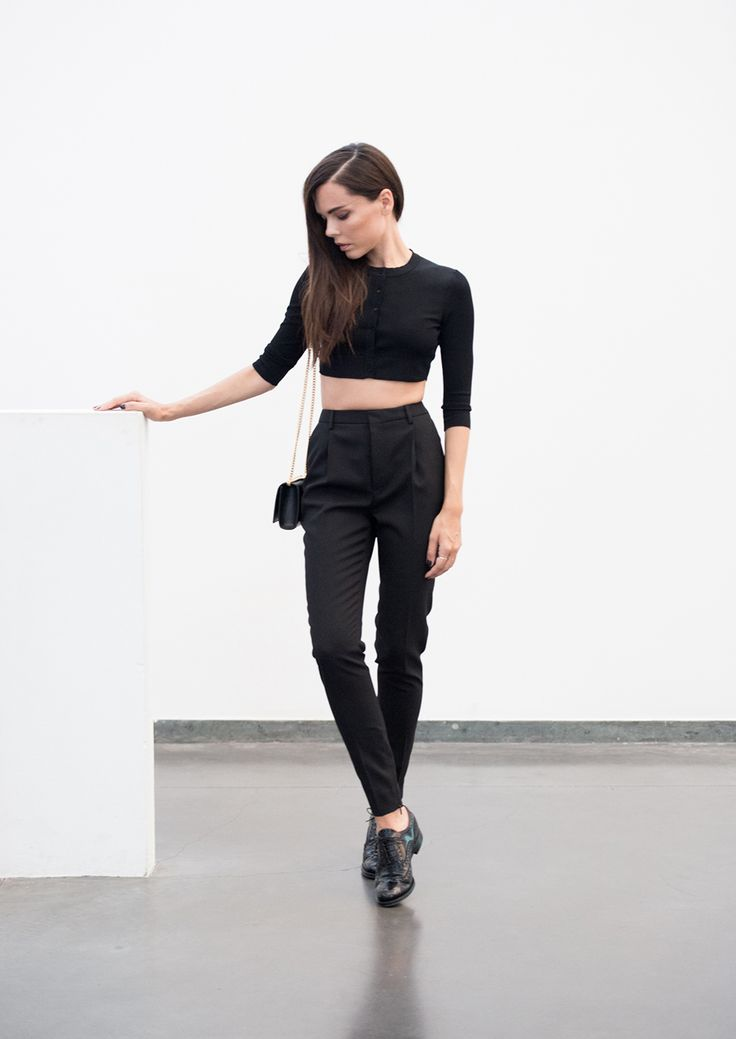 all black top from Alaia, trousers and bag from Saint Laurent,