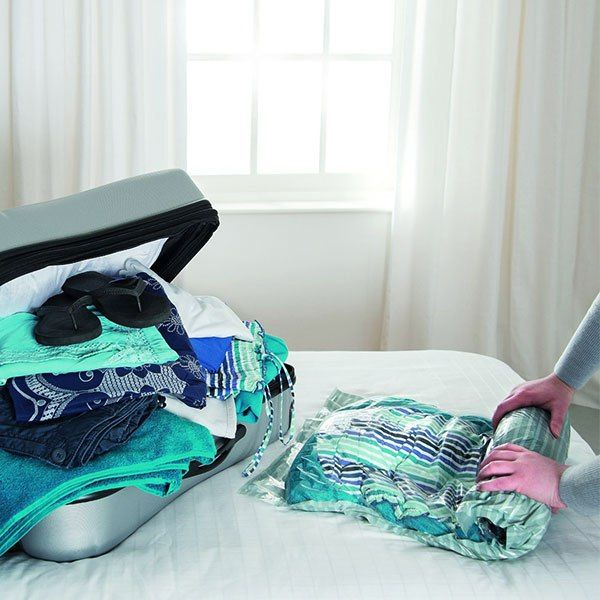 15 Brilliant Travel Accessories You Must Have - Roll Up Vacuum Bags