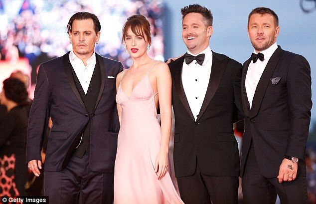 Stars of the show: Dakota and Johnny were joined by director Scott Cooper and co-star Joel...