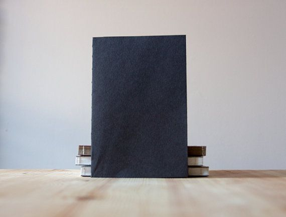 Slim Black Coptic Stitch Paper Softcover Notebook  by knotbooks