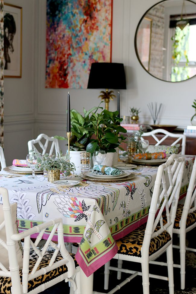 Colourful table setting with plants and animal prints