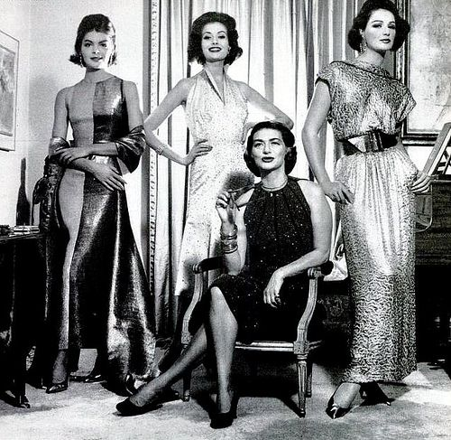 Pauline Trigere(seated) with models (Gitta Schilling center) wearing her designs, photo by Francesco Scavullo, 1959