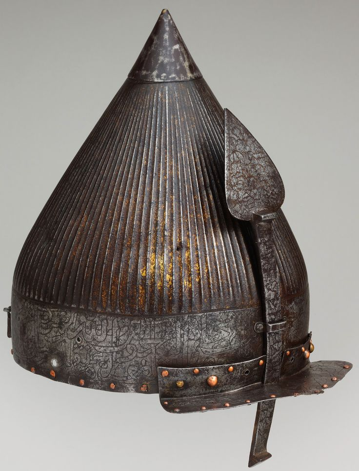 "Ottoman chichak, a type of helmet (migfer) originally worn in the 15th-16th century by cavalry (sipahi) of the Ottoman Empire, steel, engraved and gilt Dimensions: Height, 10 1/2 in. (26.67 cm). Bequest of George C. Stone, 1935, inscribed around the rim, a verse from the Koran known as the Victory Sura (48:1–4), includes the phrase: ""Verily, we have granted thee a manfiest victory."" Verses from this sura were used frequently on Ottoman armor and weapons in the sixteenth century."