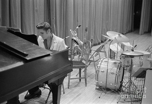 The Phillip Harrington Collection - Elvis Presley on piano waiting for a show to start 1956