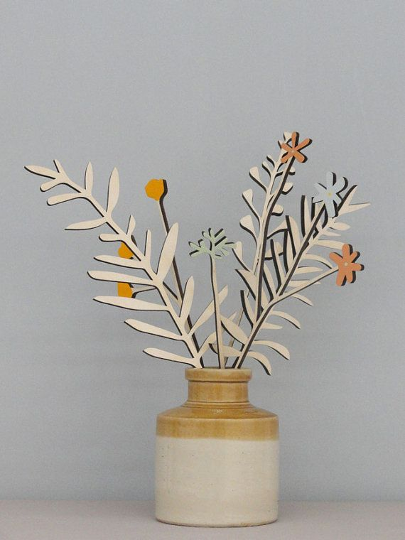 He encontrado este interesante anuncio de Etsy en https://www.etsy.com/es/listing/195915710/wooden-flowers-plywood-flowers-wooden