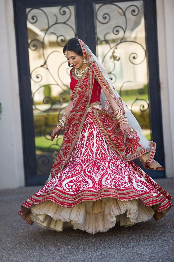 This is a unique spin off the traditional Indian bridal lengha. I personally wouldn't wear it, but this is very pretty.