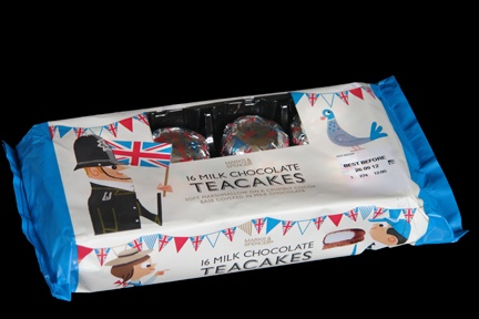 Marks and Spencer chocolate teacake packaging decorated with illustrations of a British bobby, Union Jack flags, school children, birds and bunting