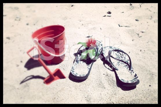 Kiwiana Christmas; Jandals with a Bucket & Spade royalty-free stock photo