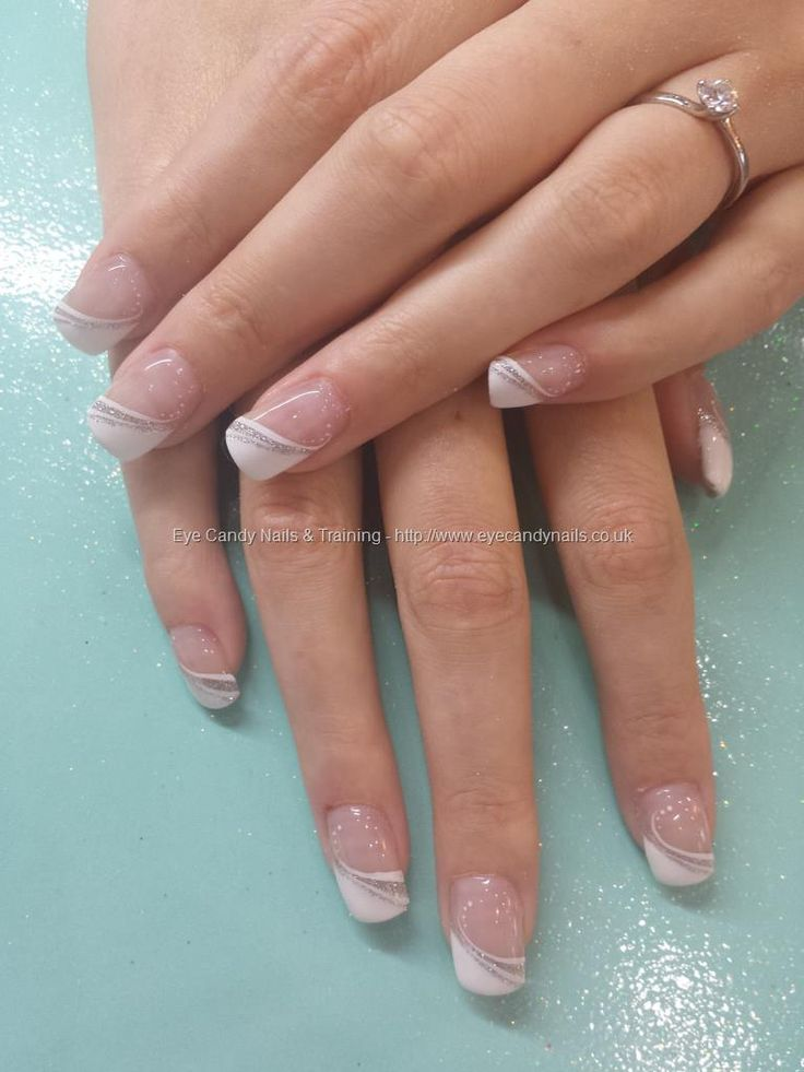Alternative white french with silver #NailArt #Nails Taken at:28/06/2014 14:15:34 Uploaded at:03/07/2014 19:03:34 Technician:Elaine Moore