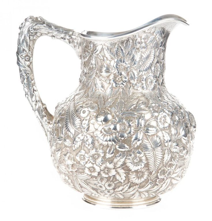 Kirk repousse sterling silver water pitcher.