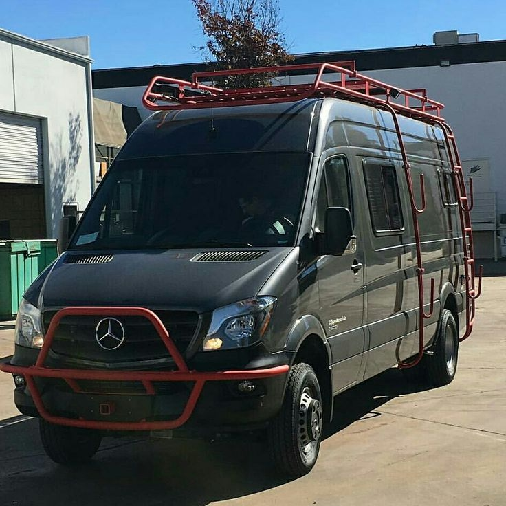 Great color combo! Aluminess roof rack, ladder and front light bar