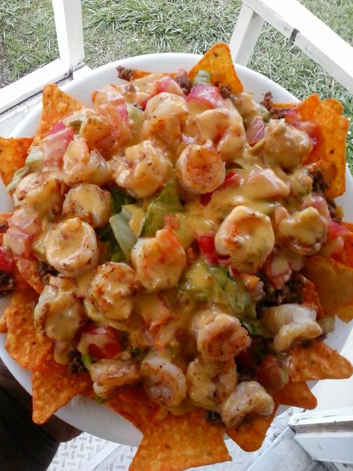 OMG Shrimp & Beef Nachos: Layer spicy Doritos, taco seasoned ground beef, tomatoes, lettuce, black olives, grilled shrimp and nacho cheese sauce