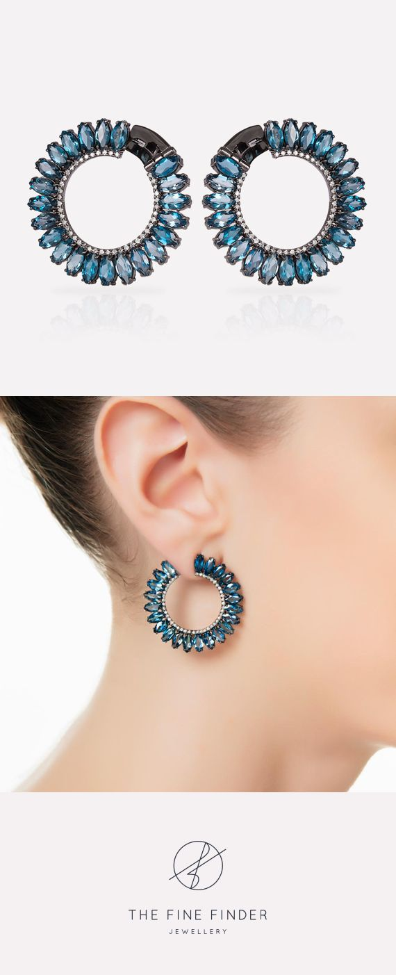 Absolutely powerful! This is the best way to describe the hoop earrings of the Deep Dreams Collection. A sequence of London Blue Topaz in marquise shape creates a perfect circle, which is supported by a line of tiny diamonds.  This combination – black gold with London Blue topaz and diamonds – will make you shine at unforgettable nights! Dreams come true when you believe them.  Also available in white gold.