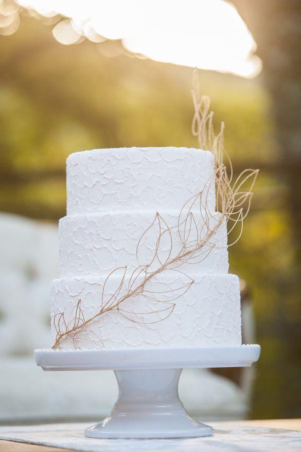 simple white three-tiered wedding cake with birch
