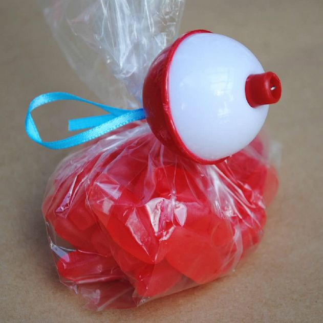 Sweedish fish tied with a bobber for a fishing themed birthday party or a Gone Fishing party.