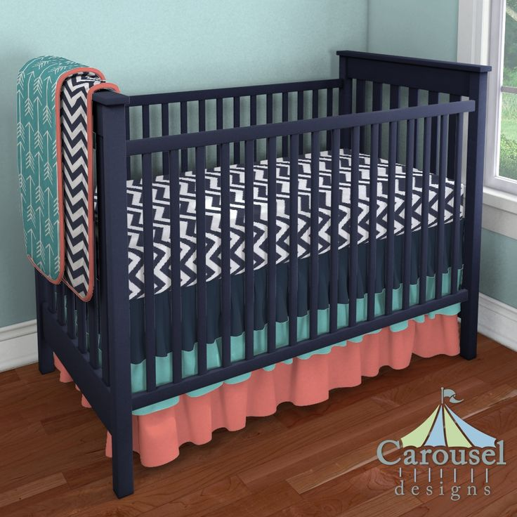Crib bedding in White and Navy Zig Zag, Turquoise Arrow, Solid Coral, Solid Navy, Solid Teal. Created using the Nursery Designer® by Carousel Designs where you mix and match from hundreds of fabrics to create your own unique baby bedding. #carouseldesigns