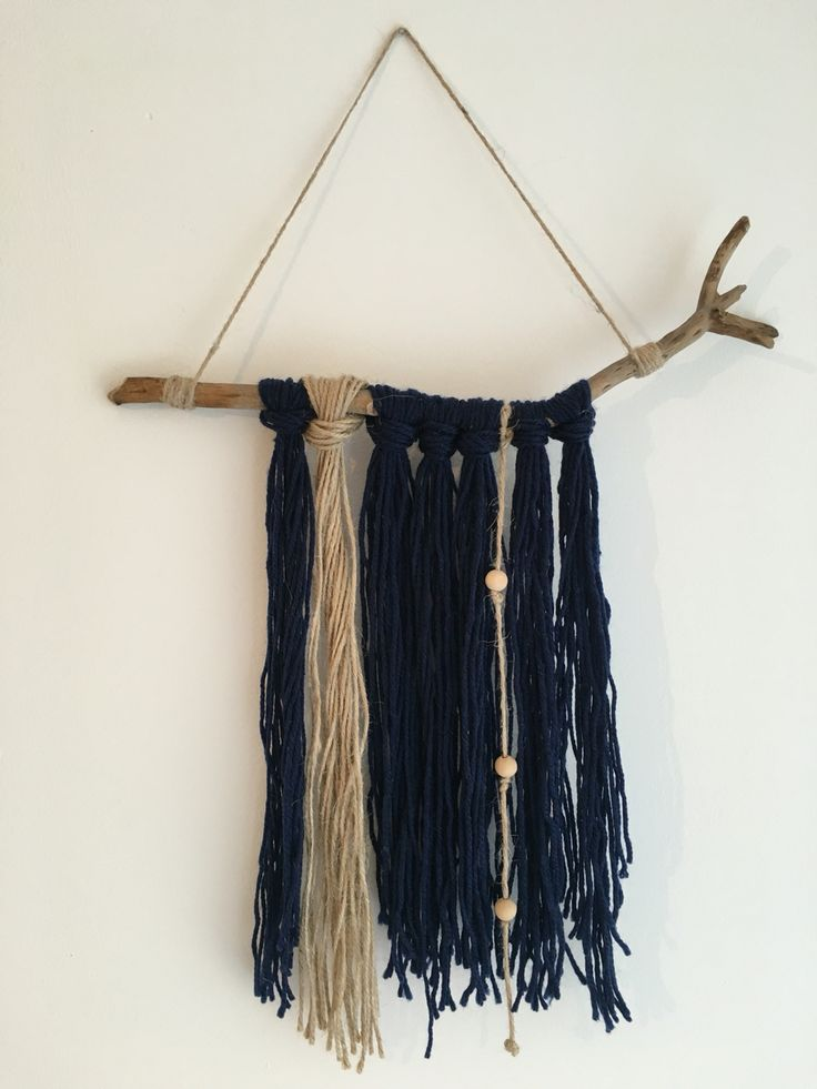Rustic wall hanging made with wool, string and beads