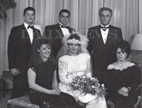 "In this rare photo featured in the book ""Shadow of My Father"" by John (Junior) Gotti pictures (l. to r. back row) Peter Gotti, John (Junior) Gotti, John Gotti and (front row) Angel Gotti, Kimberly Albanese (Gotti) and Victoria Gotti at the wedding of John (Junior) Gotti in 1990."
