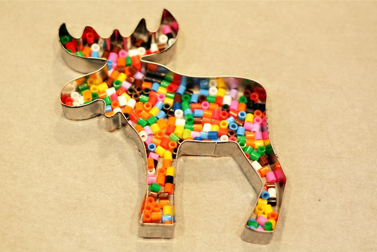 place perler beads in cookie cutters, bake in the oven to melt,