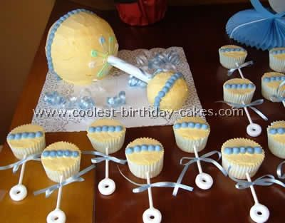 Creative Baby Shower Cakes  Not loving the big cake but I love the Rattle Cupcakes!