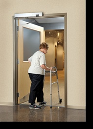 Norton SafeZone is a revolutionary closer/holder that senses movement in the door opening and stops the door from closing. A physically disabled person in a wheelchair; an elderly person moving slowly; and a child who stops to pick up a toy— all are safe to move through the door opening at their own speed. Perfect for hospitals & healthcare facilities.