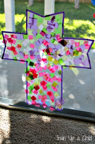 Cross Suncatcher {Easter Craft for Kids} - A collaborative, open ended art project to help teach children about the cross and Resurrection. As the sun shines through the window every morning between now and Easter we will be reminded of Christ's sacrifice.