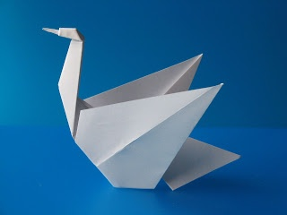 Origami: Cigno - Swan. From one uncut square of copy paper. Designed and folded by Francesco Guarnieri, July 2007.