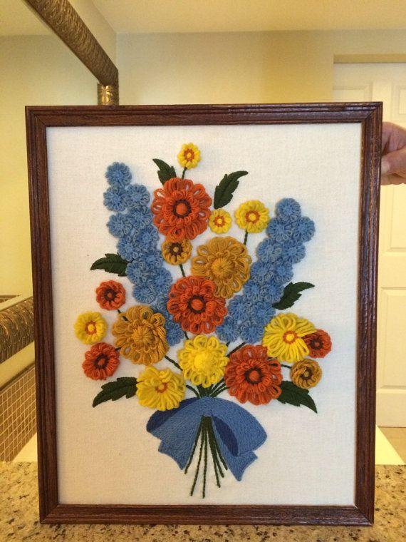 Vintage crewel embroidery of a bouquet of flowers. $67.00