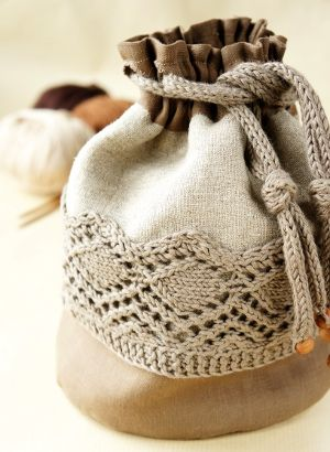 Linen knitting project bag. knitted lace trim on fabric bag w/ knitted i-cord draw cord