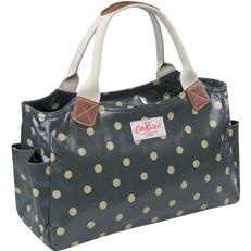 Cath Kidston :-)  I have this purse from my second trip to London.  Love love love it!
