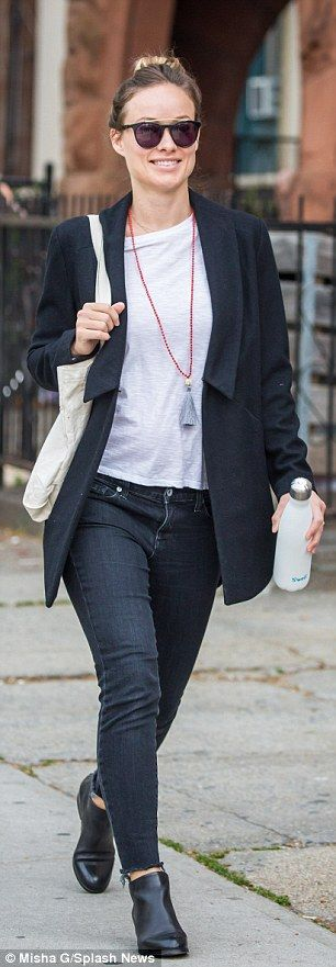 Street chic! The former House actress donned black light wash denims and asymmetrical wool...