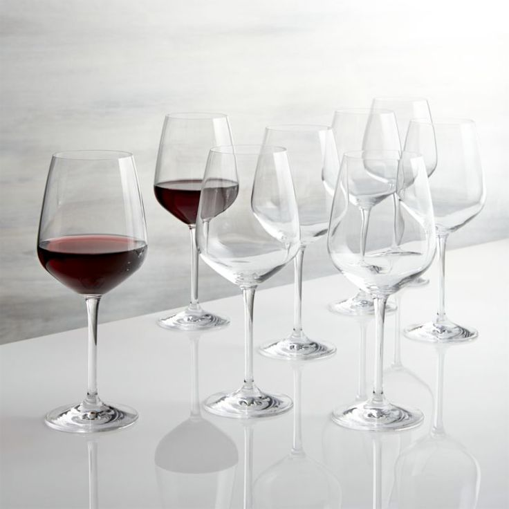 Shop Nattie Red Wine Glasses, Set of 8.  Nattie's tulip-shaped bowls square up just a bit to put a modern angle on classic glassware.