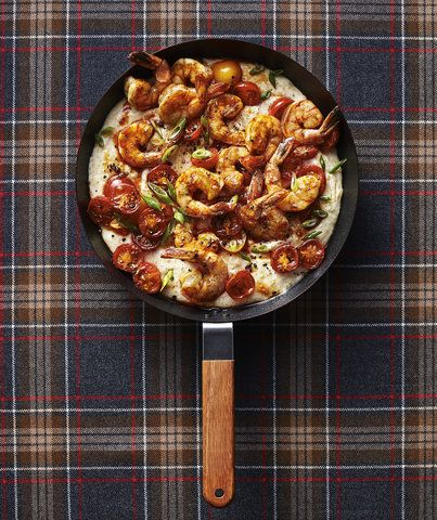 Polenta Bake With Shrimp | This Southern-inspired single skillet dinner is warming and hearty—like comfort food all grown up. It's simple and quick enough for a weeknight, and the whole family will be grateful. Whole milk and Parmesan cheese give the polenta an extra dose of creaminess, and plenty of large tail-on shrimp get tossed in paprika and butter for layers of decadent flavor. For maximum charring with minimal hands-on work, the shrimp and cherry tomatoes are broiled before being…