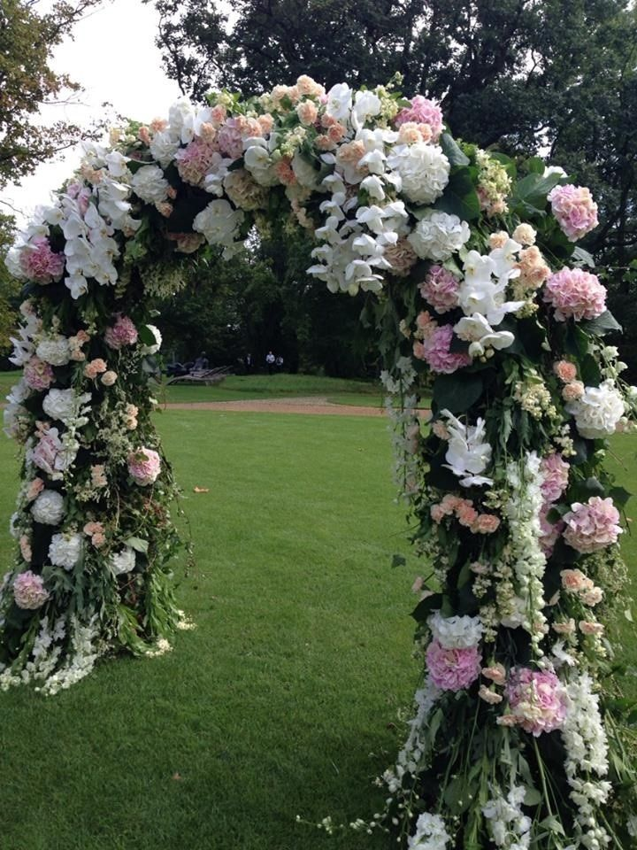 Pink and white wedding flower arch