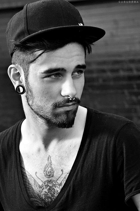 he looks like my boyfriend... minus the piercings. <3 yum.