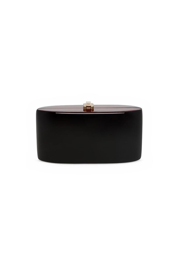 Beautiful veneer clutch bag in the signature candy shape. Slick modern vibe to a luxury clutch which has a chic retro feeling. A slick addition to a beautiful outfit. Rich midnight black. A unique work of art by British brand Rocio, epitomising eco-luxury and glamour in its purest sense. Perfect size for all your essentials, making this a great day to evening accessory. x
