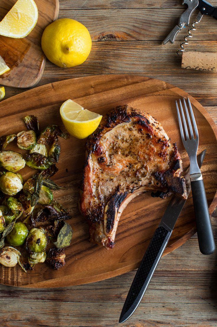 NYT Cooking: In this convenient sheet pan supper, bone-in pork chops are coated in a spicy, garlicky cumin rub before being cooked alongside  brussels sprouts and sage leaves. Roasted at high heat, the sprouts get golden at their edges and tender at their cores while the sage leaves turn brown and crisp all over, almost as if you'd fried them. Feel free to double this recipe. Just use large rimmed sheet pan...