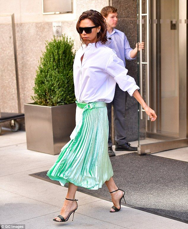 Wet hair, don't care: She stepped out with her wavy brunette tresses still…
