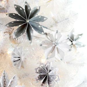 This twist on cutting paper snowflakes adds a shimmering elegance to your tree. Cut a 14-inch strip from white or silver paper. Accordion-fold the strip. Using a decorative-edge scissors, cut the tips into a point or a rounded edge. Make additional cuts if desired. Bring the ends together to form a circle; glue. Decorate each snowflake with gems and glitter glue.